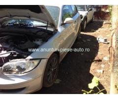 Dezmembrez BMW seria1 E81 coupe volan DR. motor N43