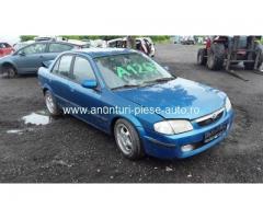 Dezmembrez Mazda 323 C IV